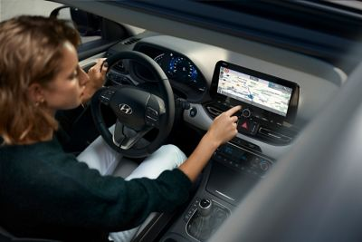 Close-up of the Hyundai navigation system with a list of points of interest.